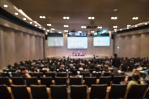 abstract-blurred-photo-conference-hall-seminar-room-with-speakers-stage_41418-2622